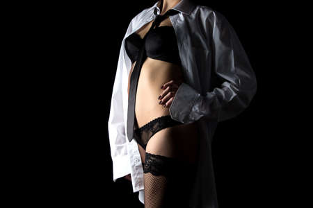 sexy stockings: Sexy woman in mens shirt and lingerie on black background