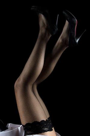 no heels: Image of woman raised legs up on black background