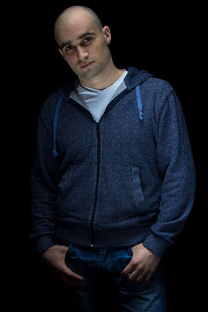 hairless: Photo of young hairless man on black background Stock Photo