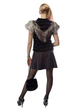 nape: Image of woman with handbag,  turned back on white background