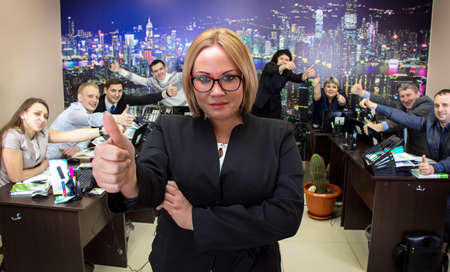 Image of business woman in glasses in office