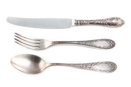 antiquarian: Image of antiquarian silver fork, spoon and knife on white background