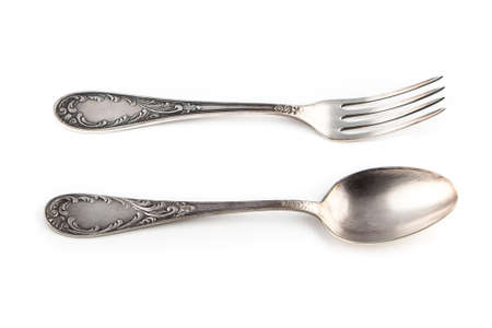 antiquarian: Image of antiquarian silver fork and spoon on white background