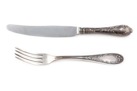antiquarian: Image of antiquarian silver fork and knife on white background
