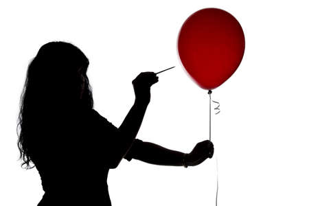 pierce: Silhouette of woman pierced with a needle balloon on white background