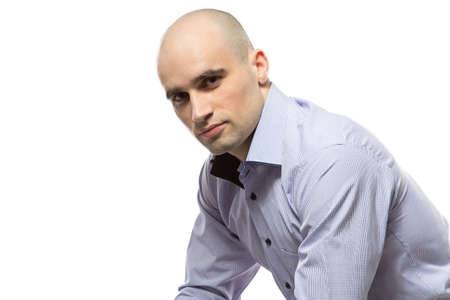hairless: Photo of sitting serious hairless business man on white background
