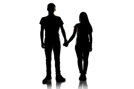 Silhouette of teenagers holding hands on white background