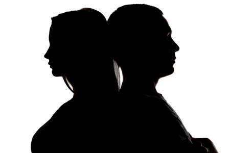 frienship: Image of silhouette teenagers looking in different sides on white background