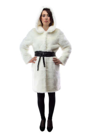 Image Of Woman In White Fur Coat With Hands On Hips On White ...