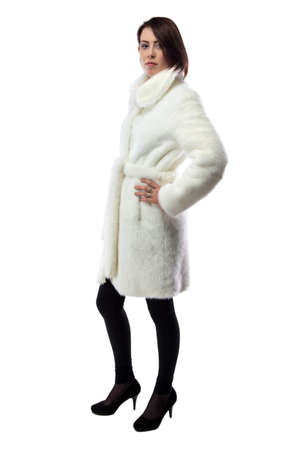 white fur: Image of woman in white fur coat, half turned on white background