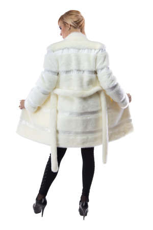 unbuttoned: Image of blonde in white unbuttoned fur coat, from back on white background