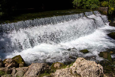 espumante: Photo of foaming flowing water among stones, summer