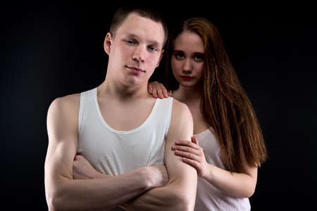 helpless: Photo of boy and helpless girl on black background
