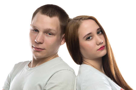 defenseless: Portrait of teenage boy and girl on white background