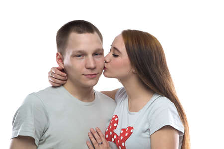 defenseless: Image of two kissing teenagers on white background