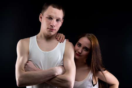 defenseless: Photo of boy with arms crossed and girl on black background