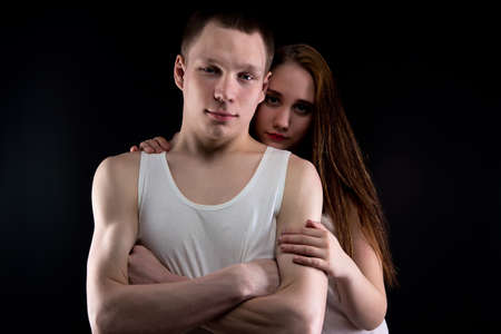 helpless: Image of boy and helpless girl on black background
