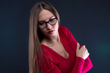 leaned: Photo of woman in glasses, leaned aside on black background