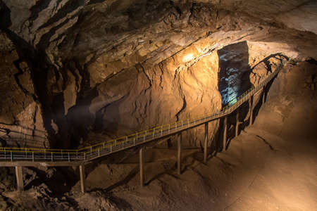 pedestrian bridge: Photo of pedestrian bridge in the cave, artificial lighting