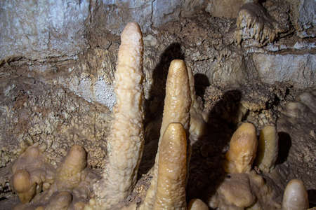 dampness: Photo of stalagmites in the cave, artificial lighting Stock Photo