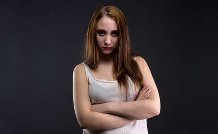 defenseless: Photo of brunette girl with dirty shirt on black background Stock Photo