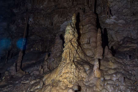 stalagmites: Photo of big stalagmites in the cave, artificial lighting