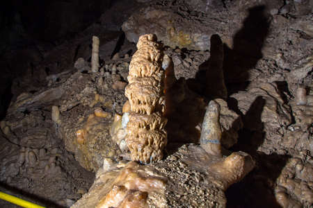 stalagmites: Image of the cave with stalagmites, artificial lighting