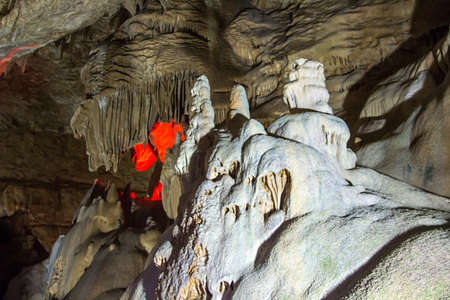 stalagmites: Photo of the cave with stalagmites, red artificial lighting
