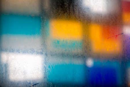 steamy: Photo steamy window, mosaic on the background