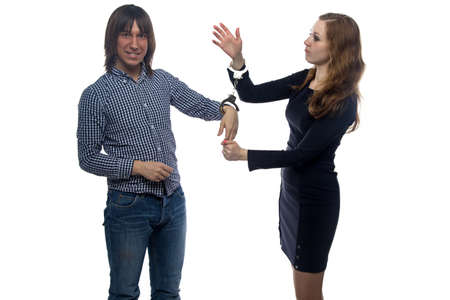 woman handcuffs: Man and angry woman with handcuffs on white background