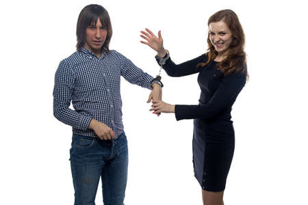 gloat: Man and gloating woman with handcuffs on white background