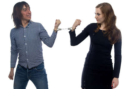 confrontation: Confrontation of serious man and woman on white background Stock Photo