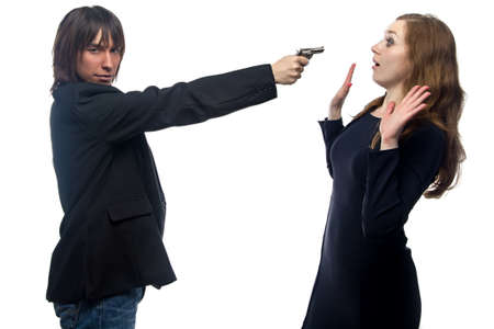 woman hands up: Man with gun threatening woman on white background