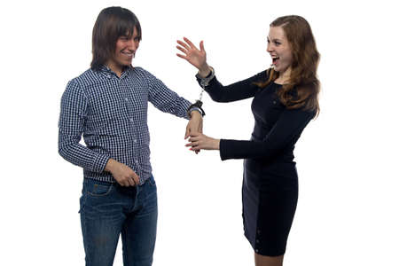 gloat: Man and gloating young woman with handcuffs on white background