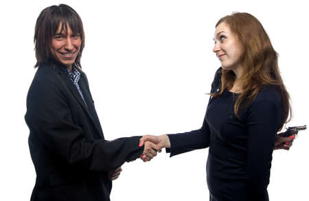 dissimulation: Woman, man, handshake and the gun on white background Stock Photo