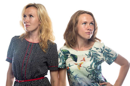 displeasure: Blond women looking at different sides on white background Stock Photo