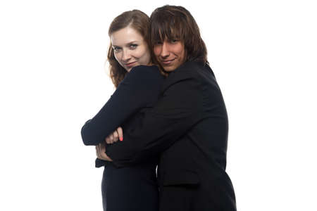 squint: Serious woman and man in black. Isolated photo with white background. Stock Photo