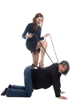 enslave: Woman putting leg on man in jacket. Isolated photo with white background. Stock Photo