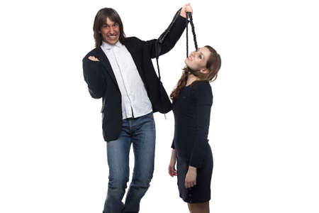 enslave: Happy man in jacket holding woman with whip. Isolated photo with white background. Stock Photo