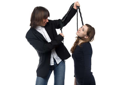 enslave: Man holding woman with whip. Isolated photo with white background.