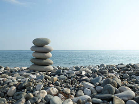 black pebbles: Black sea and pebbles, in the summer