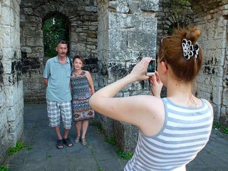 abkhazia: Tourists making photo in ruins. Travel photo. Stock Photo