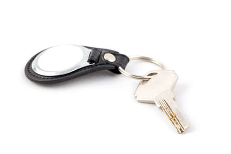 keychain: Key with keychain on white. Isolated photo of an object with white background. Stock Photo