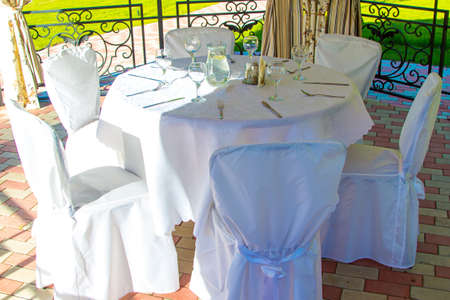 bower: Table with glasses in summer bower. Photo of summer hotel complex. Stock Photo