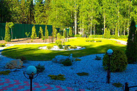 flowerbeds: Green garned with flowerbeds. Photo of summer hotel complex.