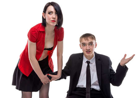 Woman and man sitting with his hand under skirt. Isolated photo of people with white background.