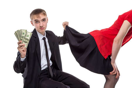 suit skirt: Woman and man with money looking under skirt. Isolated photo of people with white background. Stock Photo