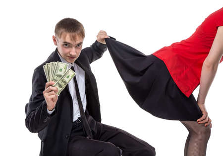 prostitution: Woman and man with money touching skirt. Isolated photo of people with white background.