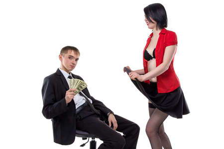 skirts: Woman showing her underwear to man with money. Isolated photo of people with white background. Stock Photo