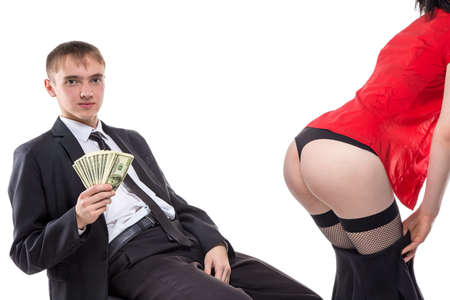 man ass: Man sitting with money and womans ass. Isolated photo of people with white background. Stock Photo